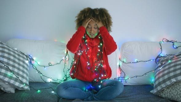 Thumbnail for Tired Woman Trying To Untangle Garland
