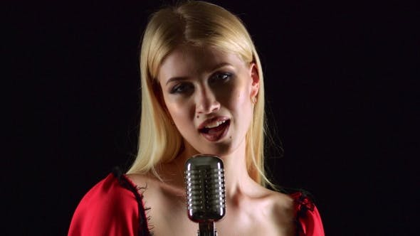 Thumbnail for Girl in Singing in Retro Microphone Hilarious Song. Black Background