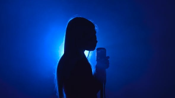 Thumbnail for Girl in Singing in Retro Microphone Hilarious Song. Smoke Background. Silhouette. Side View