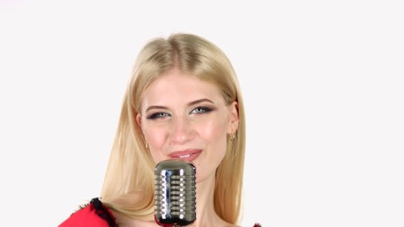 Thumbnail for Girl Dances and Sings in a Retro Microphone. White Background.