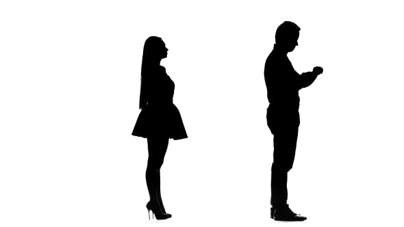 Thumbnail for Guy Is Waiting for the Girl, She Is Late, but Comes and Kisses Him. Silhouette. White Background