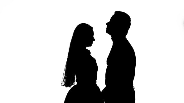 Thumbnail for Guy with the Girl Hugs and Looks at the Sky. Silhouette. White Background