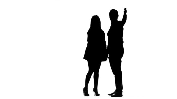Thumbnail for Couple in Love Is Waiting for Friends and Waving at Them. Silhouette. White Background