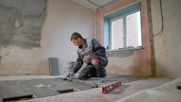 Thumbnail for Construction Worker Using Plastering Tools Renovating Apartment House. Construction Work Starts