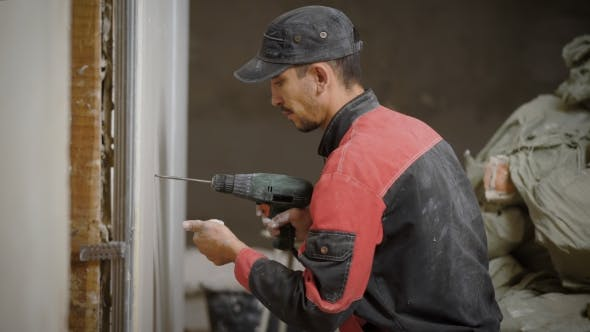 Thumbnail for Working Man Is Drilling the Drywall