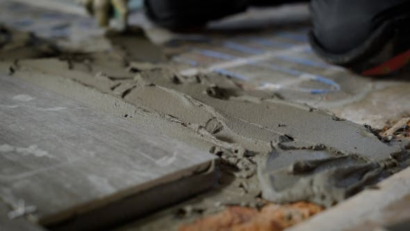 Thumbnail for Builder Hand Levelling Concrete with Trowel
