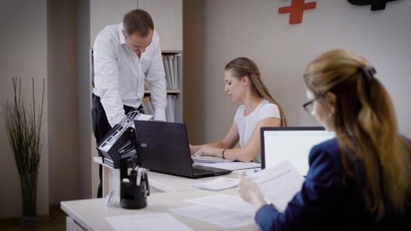 Thumbnail for Several People Look at the Documents in the Office, the Man and the Woman Work in a Law Firm, They