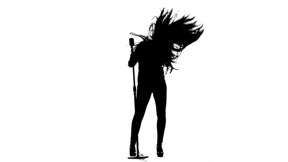Thumbnail for Actress in a Retro Microphone Sings a Rock Song. White Background. Silhouette