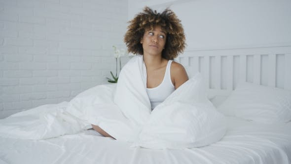 Upset Woman Cuddling in Bed