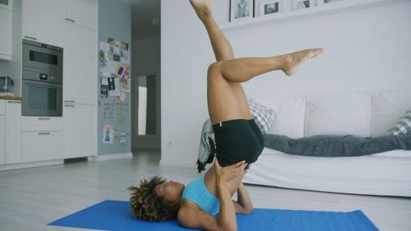 Thumbnail for Woman Balancing on Mat Training Yoga
