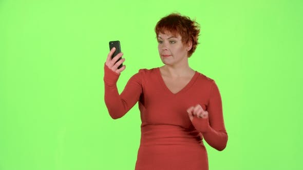 Thumbnail for Woman Is Making a Selfie. Green Screen