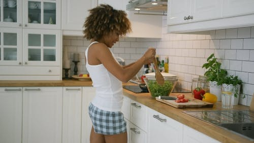 Content Woman Cooking Ad Dancing