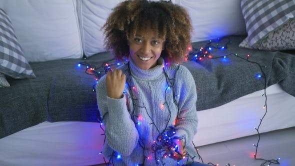 Thumbnail for Smiling Model with Christmas Lights