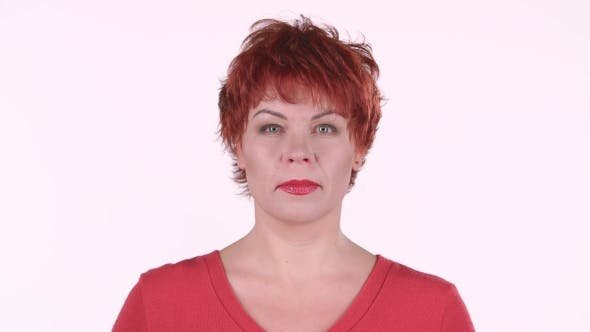 Thumbnail for Redhaired Woman Looks Into the Distance and Smiles. White Background
