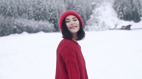 Thumbnail for A Beautiful Smiling Girl in Winter in