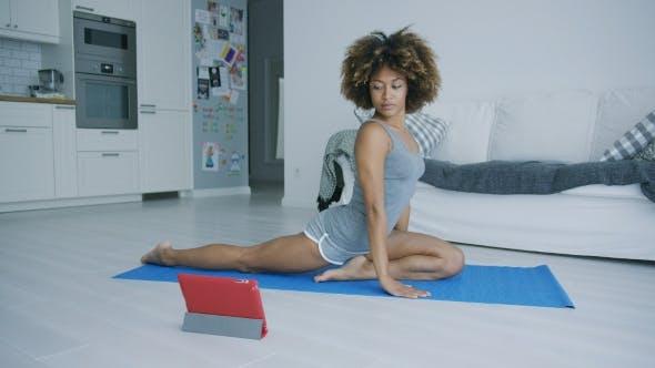 Thumbnail for Young Woman Practicing Yoga Watching Tutoria