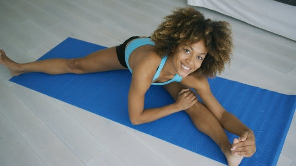 Cover Image for Cheerful Woman Posing While Stretching