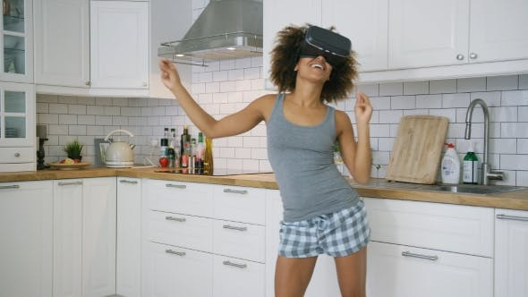 Thumbnail for Laughing Woman in VR Glasses Dancing