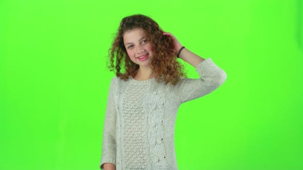 Thumbnail for Model of the Child Poses for the Cameras and Sends Air Kisses. Green Screen