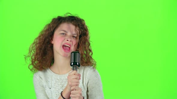 Thumbnail for Baby Girl Sings in Retro Microphone Fiery Songs. Green Screen