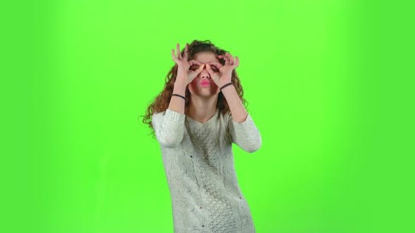 Thumbnail for Child Girl Is Making Faces. Green Screen
