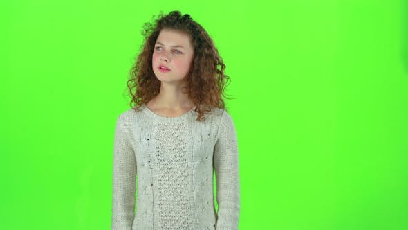 Thumbnail for Teenager Looks for Acquaintances with a Glance, Then Waves Them with His Hand. Green Screen