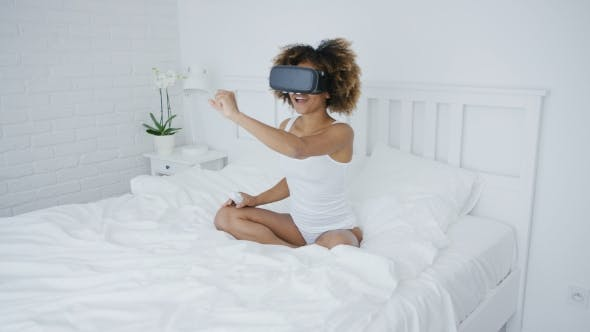 Thumbnail for Content Woman in VR Glasses on Bed