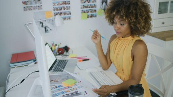 Stylish Designer Posing at Desktop