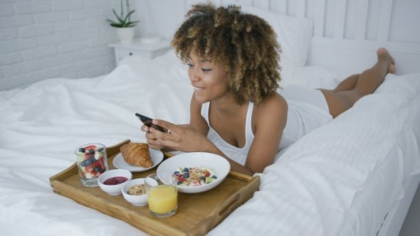 Pretty Model Having Meal in Bed