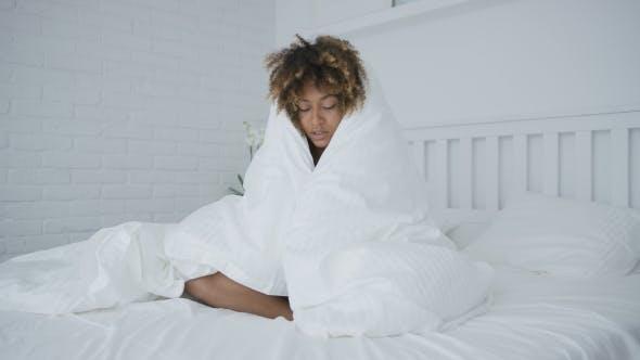 Thumbnail for Sleepy Woman Cuddling in Blanket