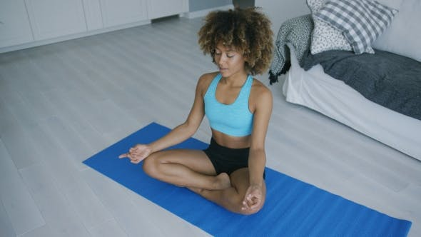 Thumbnail for Concentrated Woman Practicing Yoga on Mat