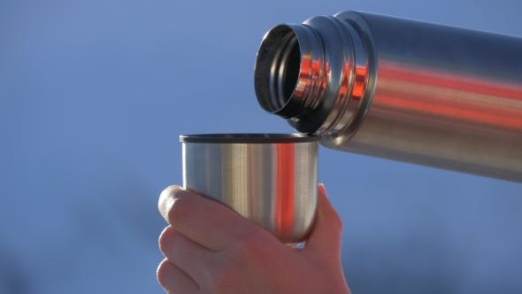 Thumbnail for Pouring Tea From a Thermos Into a Mug
