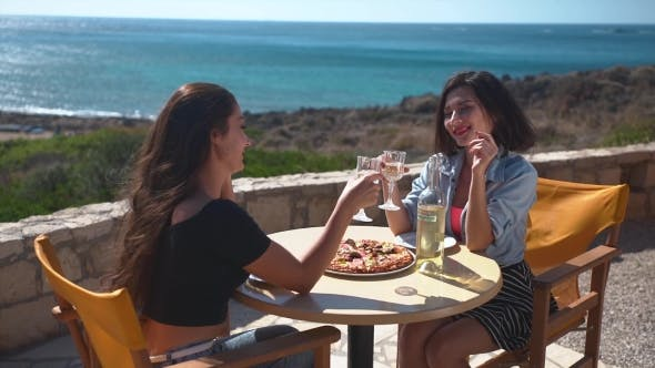 Thumbnail for Happy Girls at Beach Cafe Drinking Wine