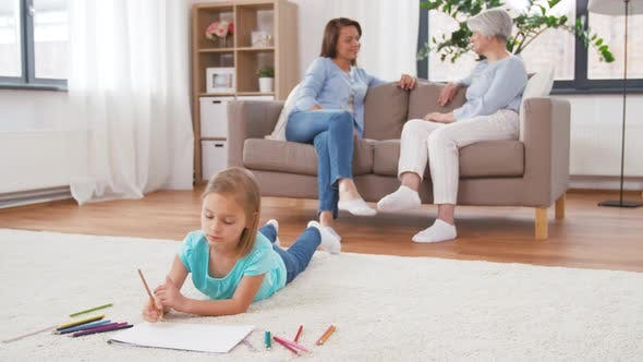 Adults Talking and Girl Drawing at Home 46
