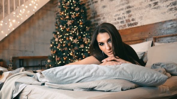 Thumbnail for Sexy Woman with Dark Hair Lying on the Bed