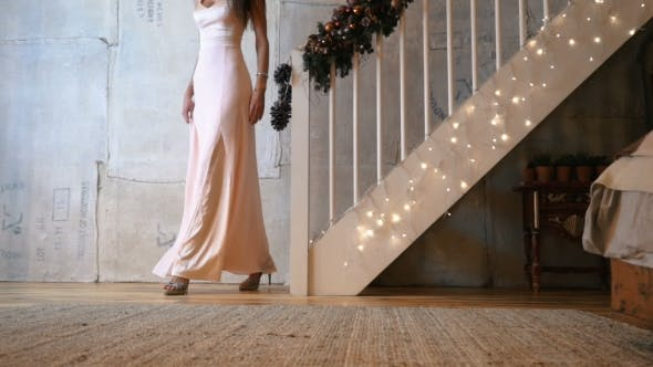 Thumbnail for Attractive Female Legs with Shoes Walks Down the Stairs