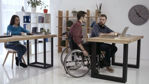 Thumbnail for Disabled Worker and Colleagues Working in Office