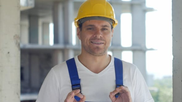 Thumbnail for Construction Worker Talks To Camera in Front of Building Site