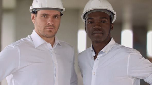 Thumbnail for Two Engineers, a Caucasian and an African American, Posing Looking To the Camera