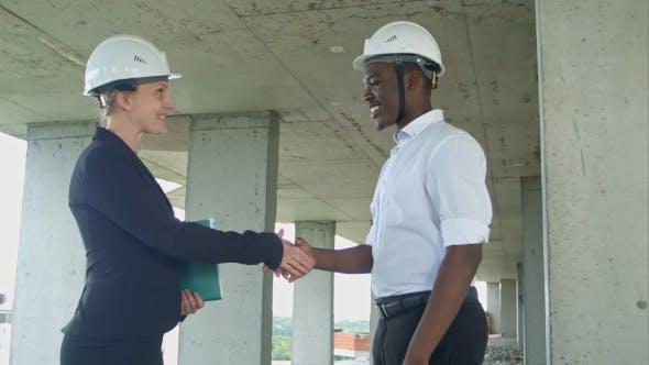 Handshake on Construction Site