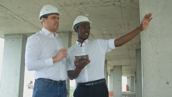 Thumbnail for Executive Team on Construction Site Reviewing with Tablet Formal Dressed People Reading Construction
