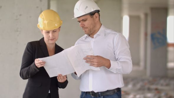 Thumbnail for Architect Team Man and Woman Discussing About Building Plan for Construction at Job Site