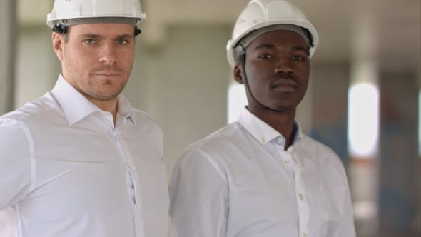 Thumbnail for Two Businessman Looking at Camera Inside Construction Site