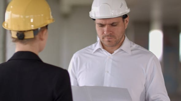 Cover Image for Business People Man and Woman Discussing About Building Plan for Construction at Job Site