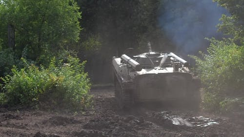 Military Machine Infantry Driving on Road at Shooting Range Back View