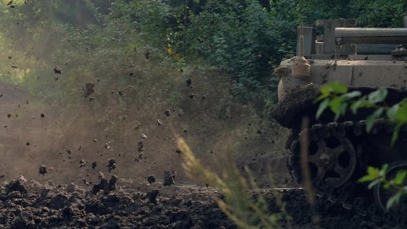 Mud From Caterpillar Tracks on Army Tank Moving on Military Operation