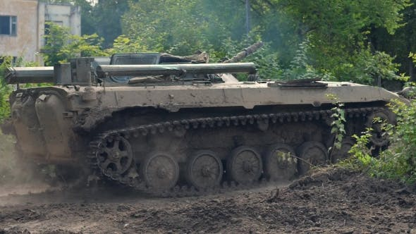 Military Tank Moving on Background Destroy Building During Hostilities
