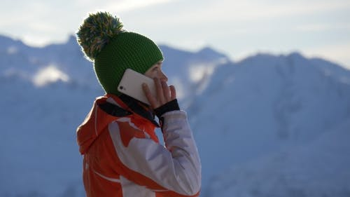 Girl with Phone and the Contours of the Mountains