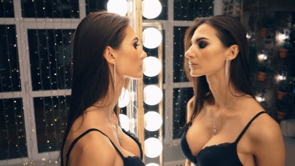 Thumbnail for Sexy Tall Lingerie Woman Looking Into Mirror While Getting Dressed