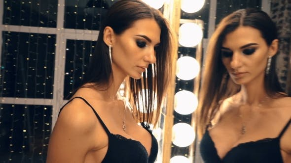 Thumbnail for Sexy Tall Woman Looking Into Mirror While Getting Dressed